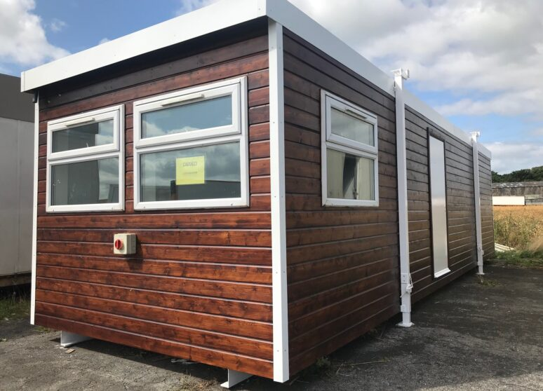 Second hand timber clad portable cabin