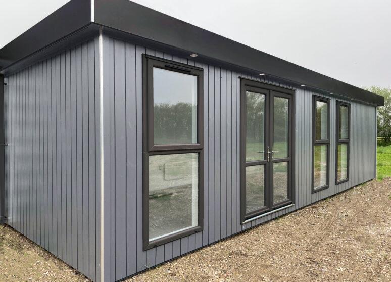 Cladded marketing cabin